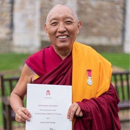Photos of Geshe Tashi receiving his British Empire Medal